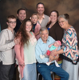 "The Garfinkles: Hayden (my kiddo), Heather (SIL), Bill (dad) holding Haleigh (niece), Pam (mom); Kevin (""baby"" brother), Asher (nephew), Steven (oldest younger brother), Me."